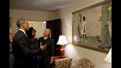 "President Barack Obama, Ruby Bridges, and representatives of the Norman Rockwell Museum view Rockwell's ""The Problem We All Live With,"" hanging in a West Wing hallway near the Oval Office, July 15, 2011. Bridges is the girl portrayed in the painting. (Official White House Photo by Pete Souza)"